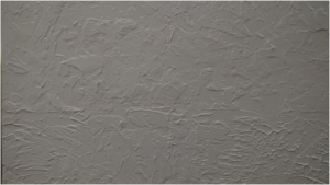 Textured Plaster with a light coat of white paint